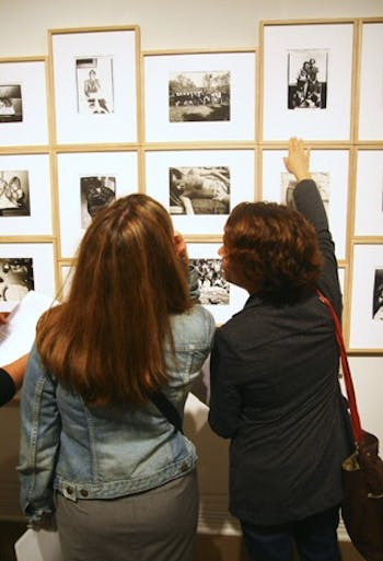 Lena Wegner (right) examines the Andy Warhol photo exhibit at the Ackland Art Museum with Lisa Voss (left) on Thursday night.