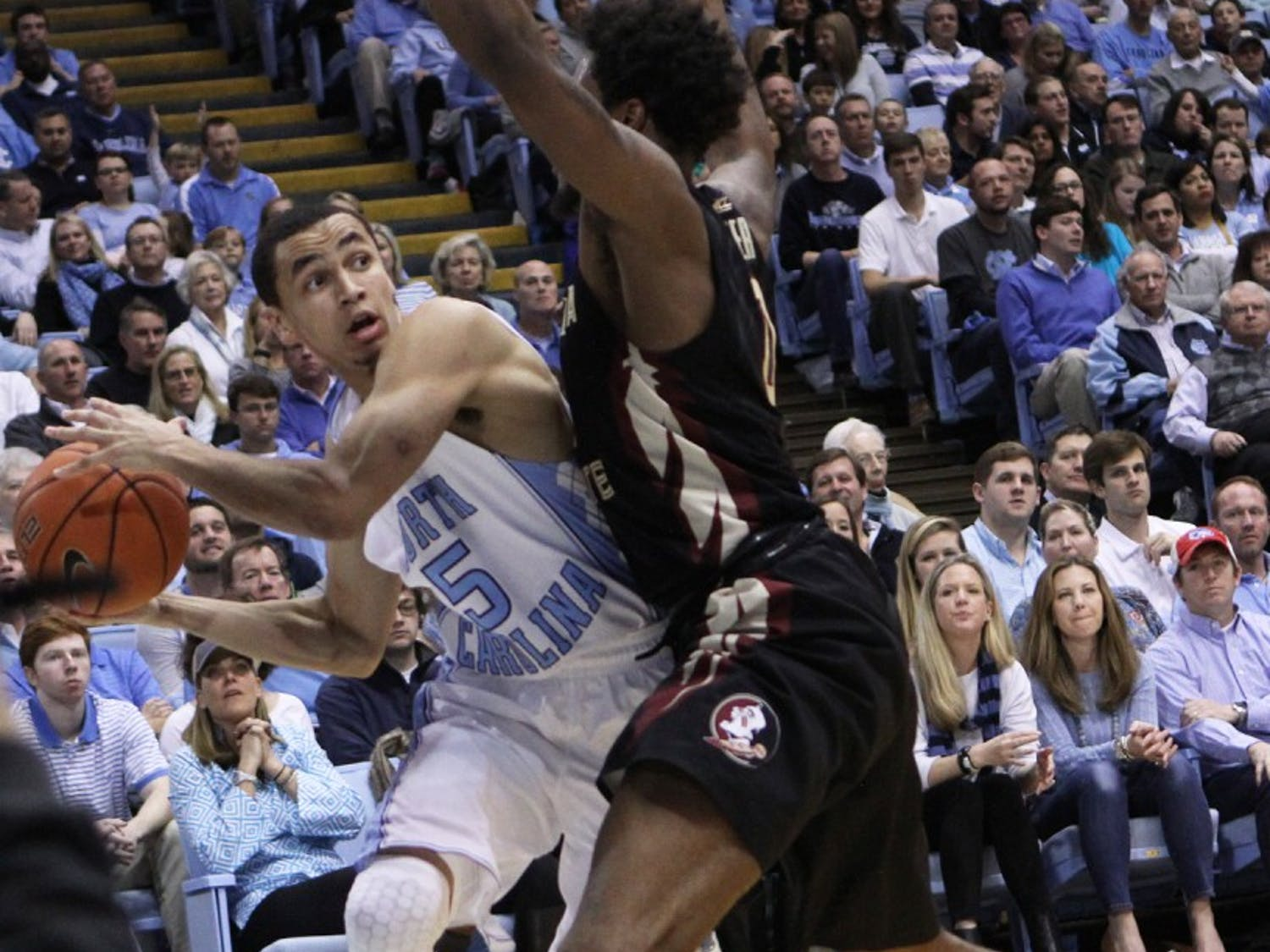 UNC junior guard Marcus Paige (5) looks to pass the ball.
