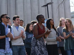 """Students sing """"We Can't Keep Quiet"""" in the event based on the recent Women's March."""