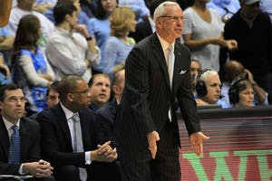 "Coach Roy Williams reacts to a call during the first half. The Tar Heels lost to the Duke Blue Devils 84-77 Saturday night. """"I'm tired of saying this but congratulate Duke. They did some really good things."""