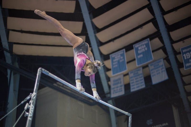 Megan Ruzicka competes on the uneven bars during home opener and annual Women's Day and Pink Meet against Oklahoma and Ball State on Saturday, Jan. 19, 2019. UNC placed second behind Oklahoma.
