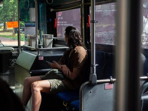 A student travels away from campus on a bus on the first day of classes, Aug. 18.