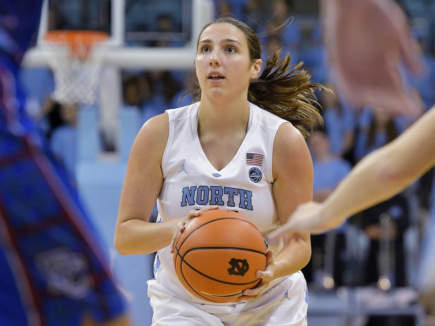Then-sophomore Liz Roberts, a walk-on guard, attempts a shot in Carolina's 91-56 win over Presbyterian at Carmichael Arena on December 5, 2017. Now a graduate assistant with the team, Roberts is hoping to use her experience at UNC as a springboard into a career in sports. Photo courtesy of Jeff Camarati/UNC Athletics