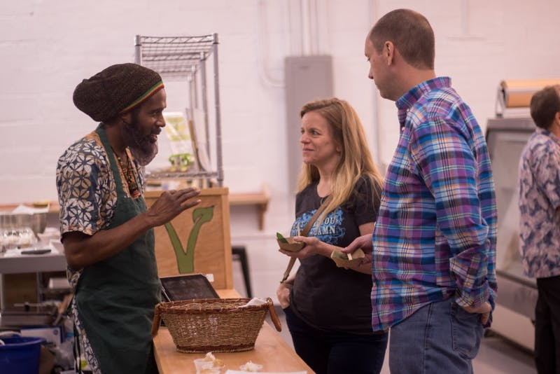 Yah-i Amen, one of the founders and owners of Vegan Flava Cafe, engages with guests at the Blue Dogwood location soon to open to the public.