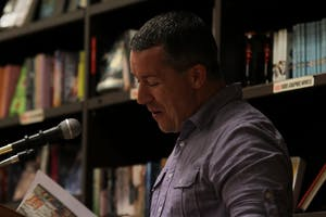 """Ty Stumpf, the Chair of the Humanities Department at Central Carolina Community College, reads poems from his novel """"Suburban Burn"""" at Flyleaf Books on Thursday evening."""