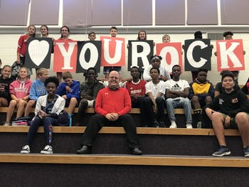 Bob Bales is the principal of McDougle Middle School in the Chapel Hill-Carrboro City Schools district. He was just named Principal of the Year for 2019-20. He is pictured here with students. Photo Courtesy of Jeffrey Nash.