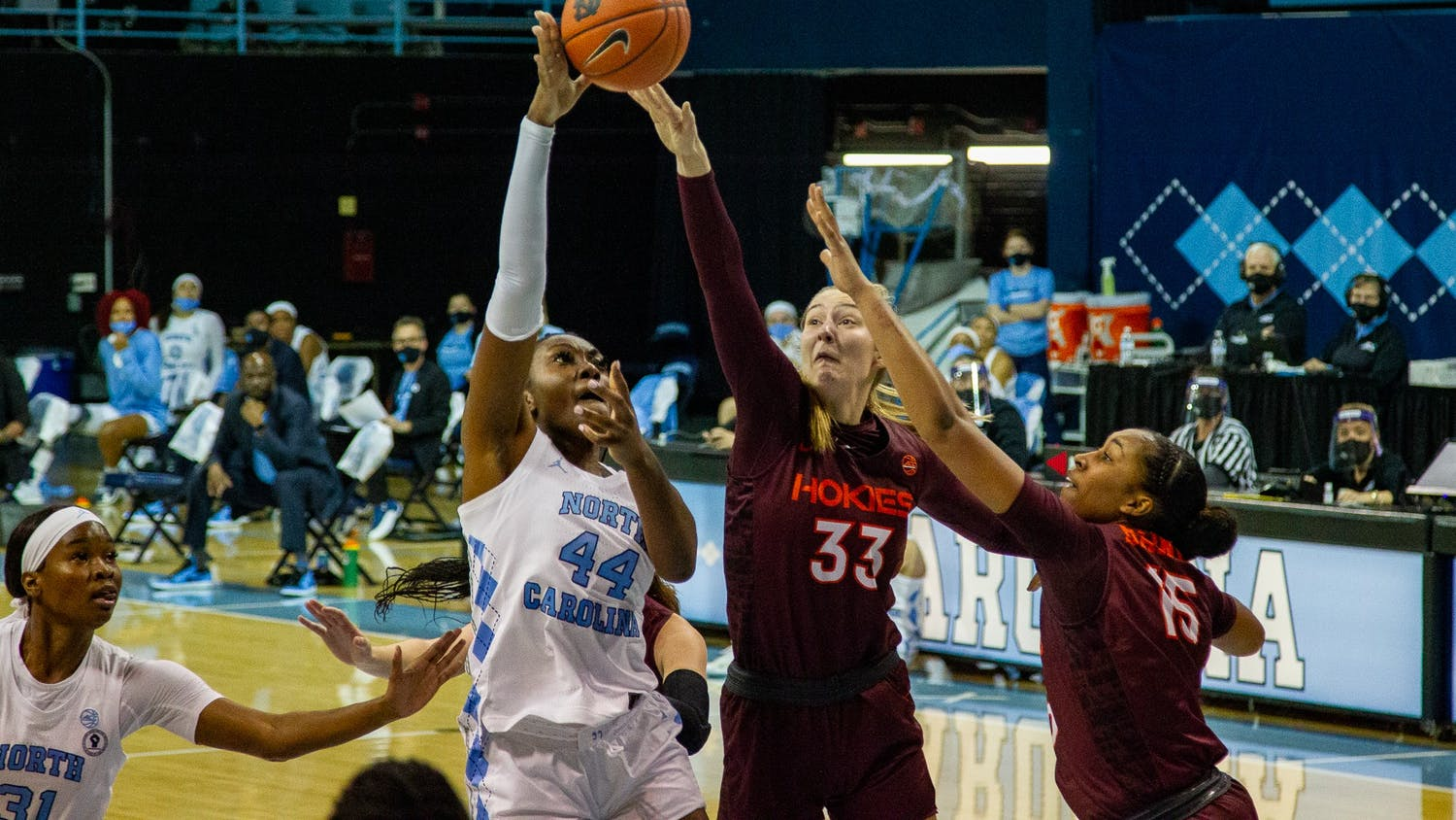 UNC senior center Janelle Bailey (44) attempts a layup in Carmichael Arena on Jan. 14, 2021 in Chapel Hill, N.C. The Tar Heels lost to the Hokies 66-54.