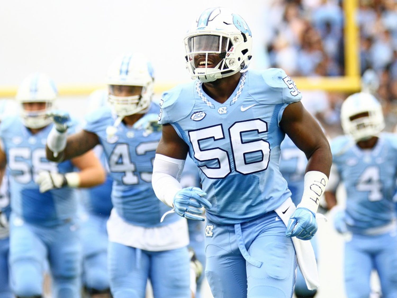 Andre Smith, then a first-year, jogs out of the Kenan Stadium tunnel ahead of a 2015 game against Duke.