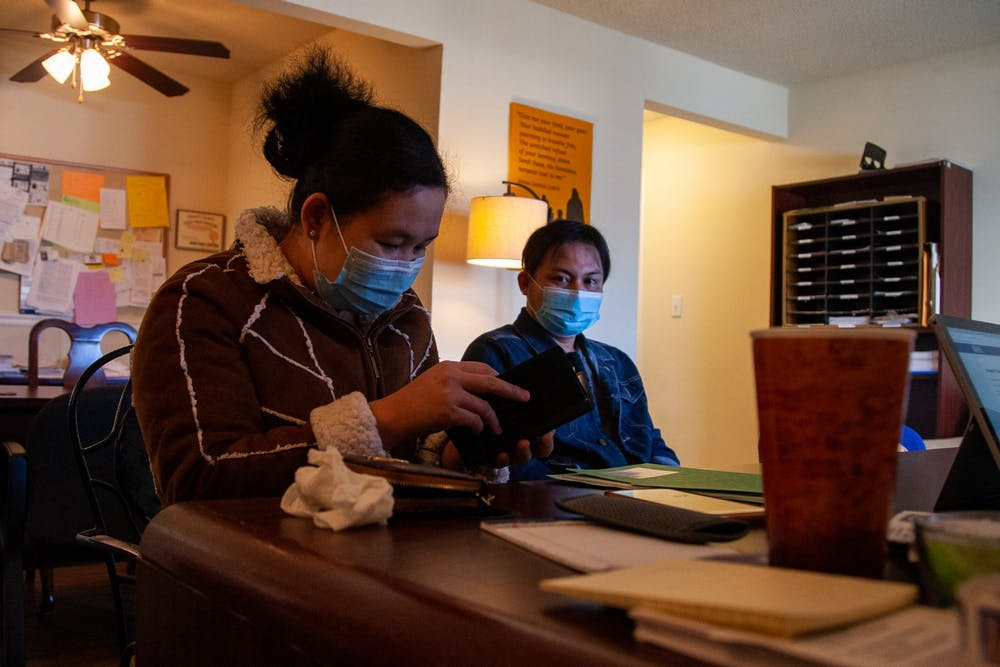 <p>Hae Taw Moo and Htun Min use a translator to communicate with volunteer Les Soden at the Refugee Support Center. The Refugee Support Center provides dozens of refugees with tax assistance every year.</p>