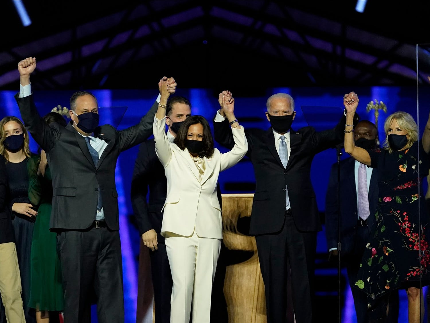 President-elect Joe Biden, Vice President-elect Kamala Harris, and their spouses grasp hands after addressing the nation from the Chase Center on Nov. 7, 2020 in Wilmington, Delaware. Photo courtesy of Andrew Harnik-Pool/Getty Images/TNS