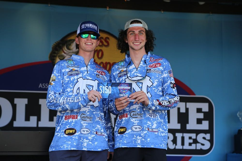 Ryan Tezzi and Mason Atwell, members of the UNC Bass Fishing Team pose with their prize at the 2021 U.S. Boat Collegiate Bass Championship at Lake Murray, SC. Photo courtesy of Mason Atwell.