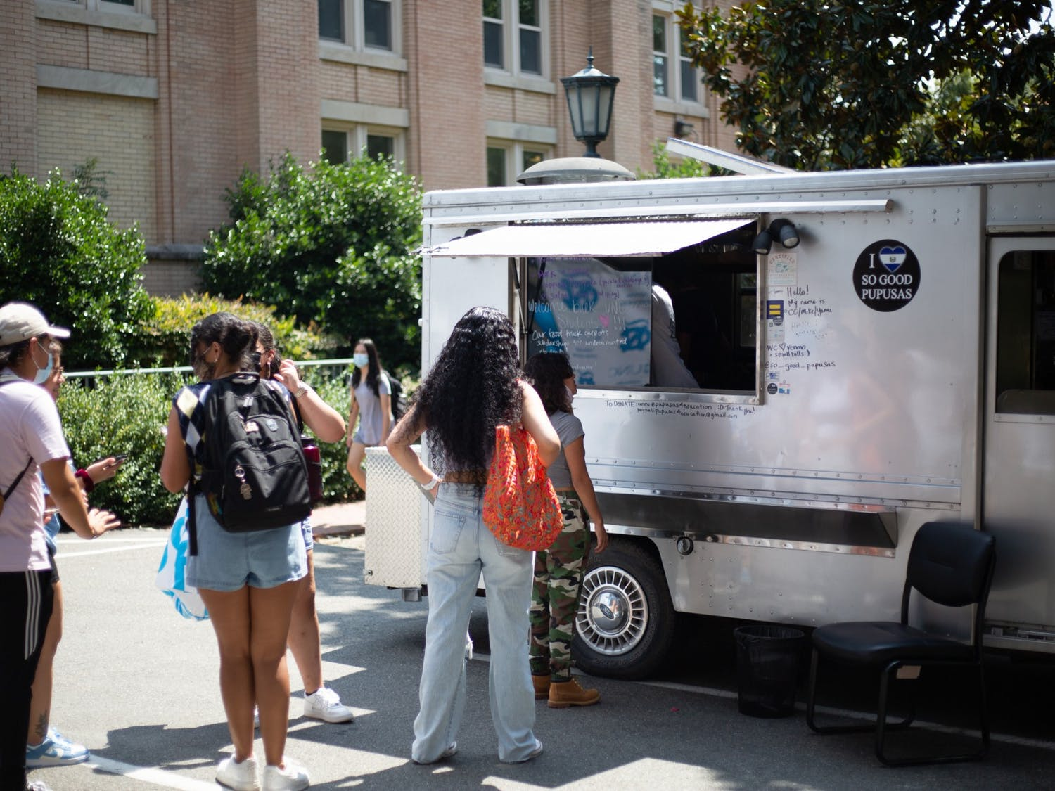Students line up for pupusas at the Carolina Latinx Center's open house event on Aug. 25.