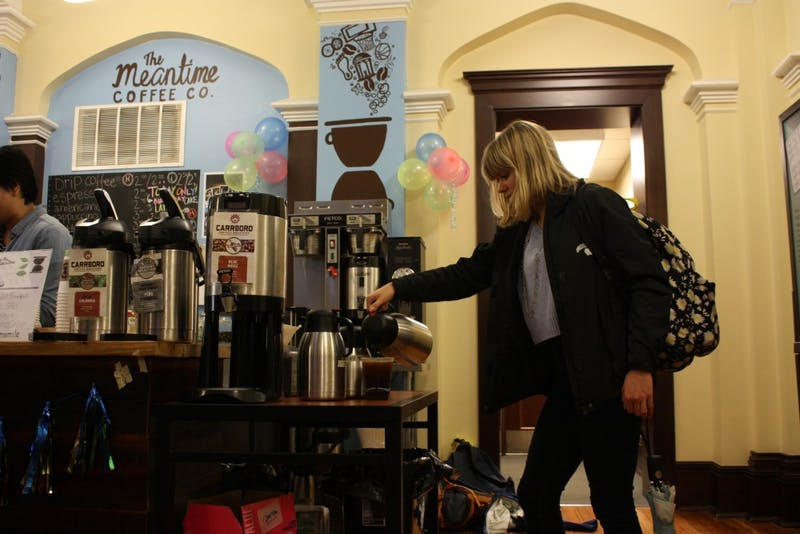 UNC senior Samantha Paisley pours coffee at The Meantime Coffee Co., which is located in the Campus Y.