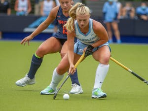 Redshirt junior back Cassie Sumfest (12) strikes the ball during the game against Virginia on Monday, Oct. 12th, 2020 at Shelton Stadium. UNC won 2-1.