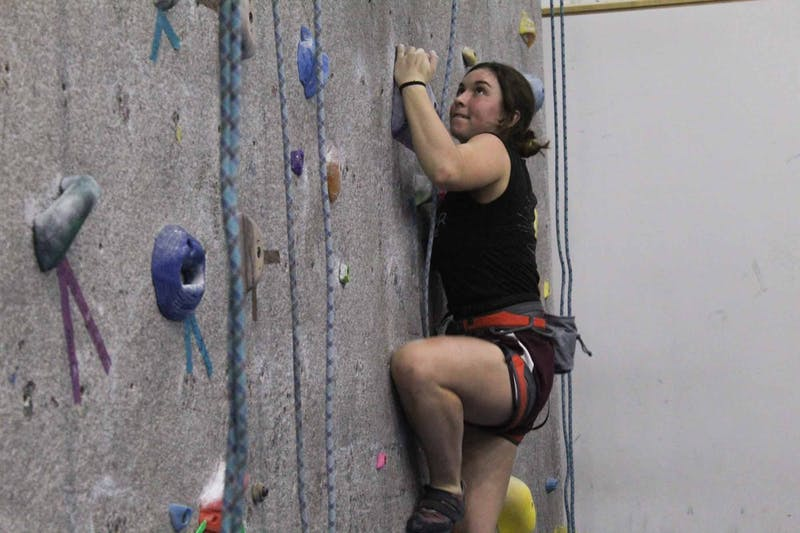 Hannah Feinsilber, a junior double-majoring in chemistry and biology, challenges herself during Rock Climbing Club practice at Fetzer Gym C on Thursday, Feb. 27, 2020.
