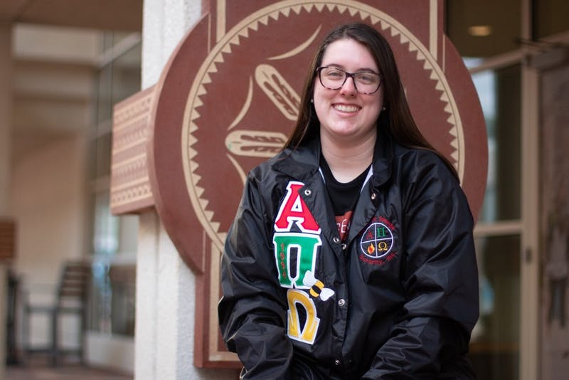 Caitlin Martin, a junior dental hygiene major, sits at The Gift Plaza beside the Student Union on Monday, March 2, 2020. Martin is a sister in Alpha Pi Omega, the first Native American sorority at UNC.