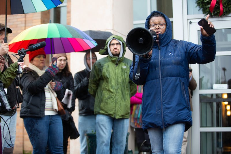"""Sophomore De'Ivyion Drew (right) delivers closing remarks during a protest at the Center for School Leadership and Development on Friday, Dec. 13, 2019. """"There is no promise that groups who share the same sentiment as Sons of Confederate Veterans won't return to campus as a group to terrorize and brutalize students,"""" said Drew to a crowd of demonstrators gathered to oppose the Board of Governors' decision to give Silent Sam and a $2.5 million fund to the Sons of Confederate Veterans."""