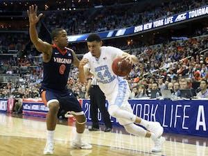 Justin Jackson (44) drives towards the basket.