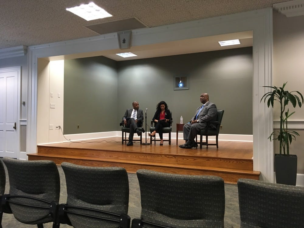 <p>Student Body President Ashton Martin (center) asks UNC Police Chief candidate David Perry (right) a question at a Q&amp;A in the Wilson Library</p>