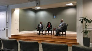 Student Body President Ashton Martin (center) asks UNC Police Chief candidate David Perry (right) a question at a Q&A in the Wilson Library