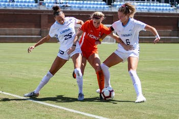 UNC sophomore defender Maycee Bell (25) and redshirt senior midfielder Taylor Otto (6) defend against Virginia Tech freshman forward Tori Powell (12). The Tar Heels beat the Virginia Tech Hokies 1-0 on Dorrance Field Sept. 20, 2020.