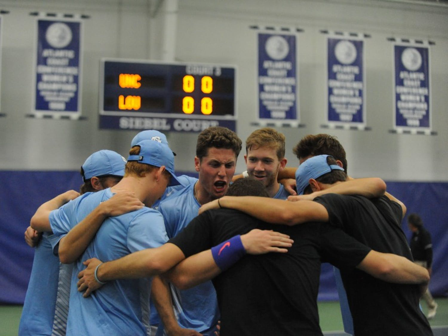 The UNC men's tennis team huddles together at the ACC tournament quarterfinals. UNC played against Louisville and won 4-0.
