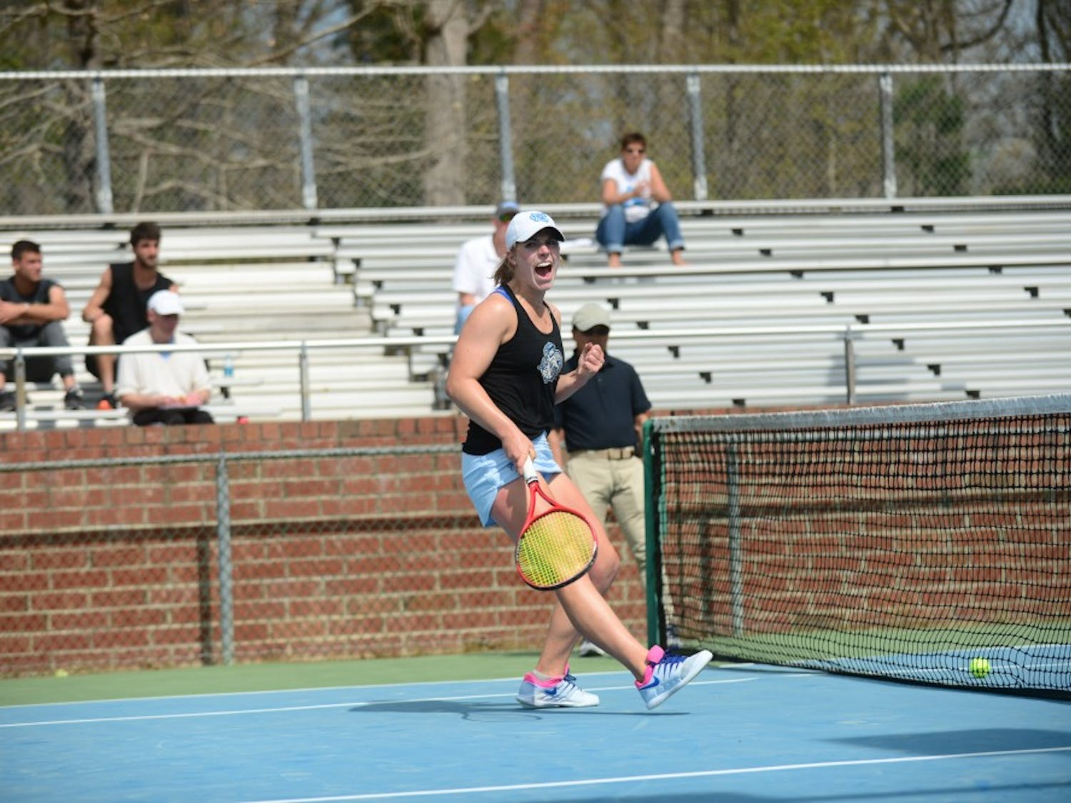 UNC women's tennis senior Jessie Aney celebrates during her doubles match against Wake Forest. UNC beat Wake Forest 7-0.