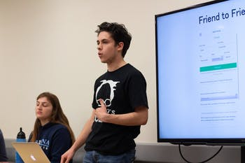 Jake Richard, a junior media and journalism major, and Sarah Ouslander, a sophomore biochemistry major, present to students in the Student Union on Tuesday, Jan. 21, 2020. Richard leads UNC Students for Bernie, an organization that supports Bernie Sanders.
