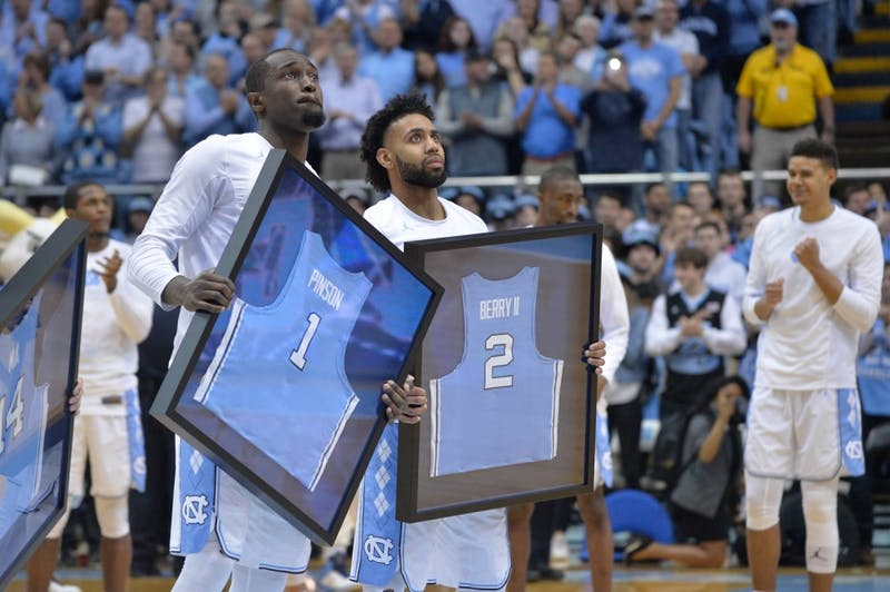 Theo Pinson (1) and Joel Berry II (2) are honored before senior night on Feb. 27 against Miami.