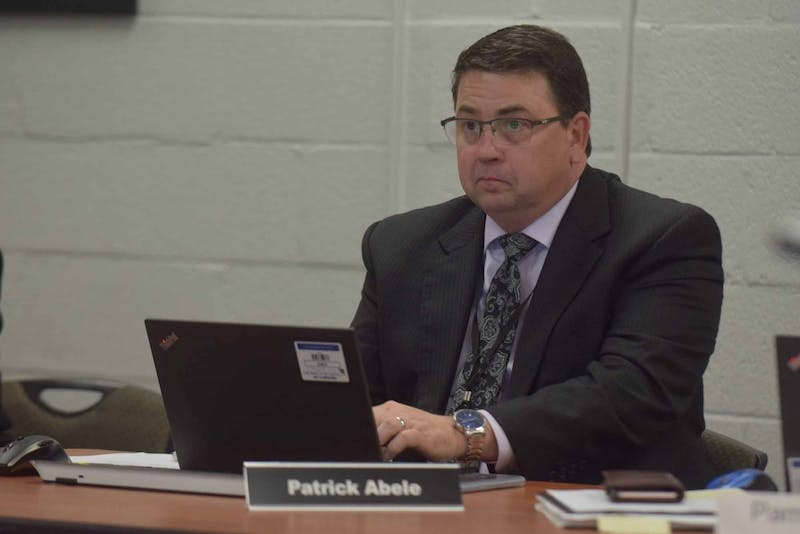 Patrick Abele, assistant superintendent of the Chapel Hill - Carrboro city schools, sits in on a district meeting on Friday, Feb. 7, 2019 at the Lincoln Center on 750 S. Merritt Mill Rd.