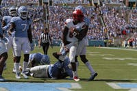 Louisville quarterback Lamar Jackson (8) scores a rushing touchdown against UNC on Sept. 9.