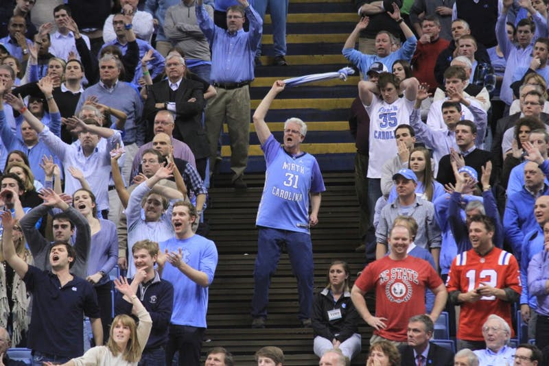 A UNC fan tries to distract an NC State player during a free throw attempt.