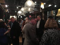 People arriving at City Kitchen for Pam Hemminger's election night party.