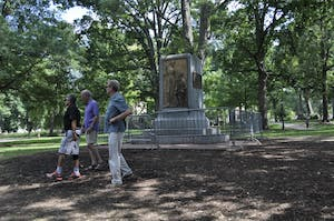 The pedestal where Silent Sam once stood surrounded by barricades Tuesday afternoon.