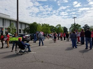 Protesters gathered together in Raleigh on Tuesday, April 21, 2020 as part of the Reopen N.C. movement. Photo courtesy of Ashley Smith.