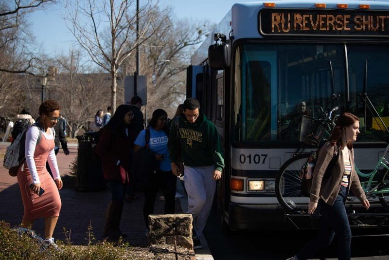 UNC-Chapel Hill Students step off the RU, a bus route of Chapel Hill Transit. The Board of Aldermen seeks to improve public transportation by working with Chapel Hill Transit to more effectively manage the current level of public transportation services in Carrboro , and extend service into areas of Carrboro not served by a fixed route service. Damon Seils, Board of Aldermen's liaison to the Transportation Advisory Board, discussed how transportation may be used to fight climate change and give more people the opportunity to use public transportation.