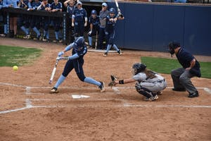 UNC freshman Sierra Parkinson swings  in a game versus UNC-G on April 4 in Anderson Stadium.