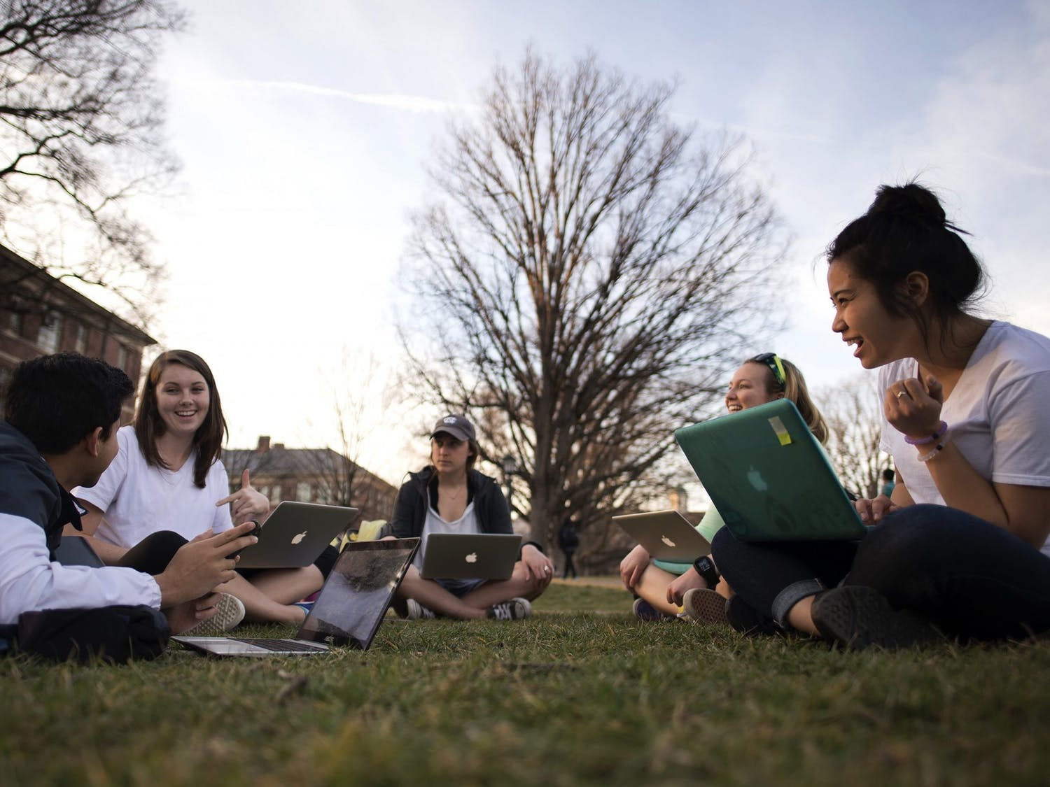 Students gather outside during a warm March afternoon on the lawns of Polk Place on the campus of the University of North Carolina at Chapel Hill.  March 8, 2016.  (Photo by Jon Gardiner/UNC-Chapel Hill)