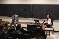 Student body president candidates Maurice Grier (left) and Elizabeth Adkins respond to questions asked by leaders of the Greek Organizations IFC, GAC, NPHC, and the PHC.