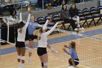 Junior Skylar Wine (6) tips the ball during the game against Miami on Sunday Oct. 11 at Carmichael Arena. UNC won 3-1.