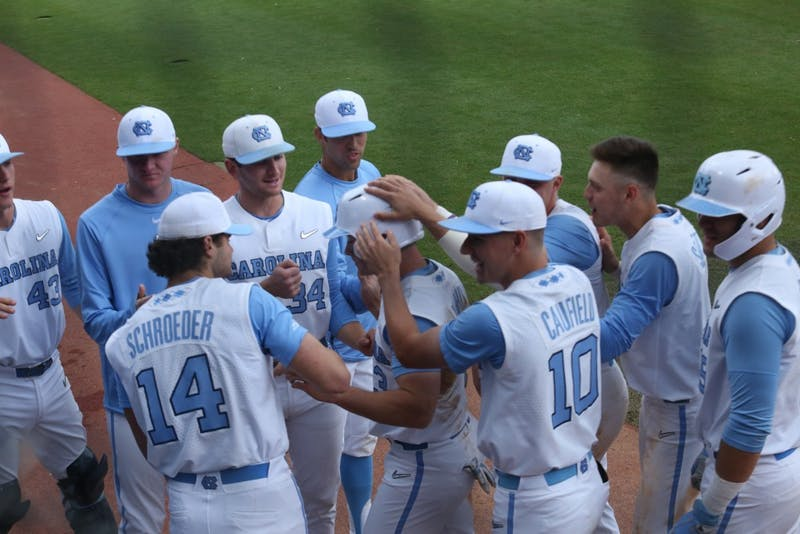 The Tar Heels' baseball team celebrates another run during their third baseball game against Boston College on Easter weekend, 2019.
