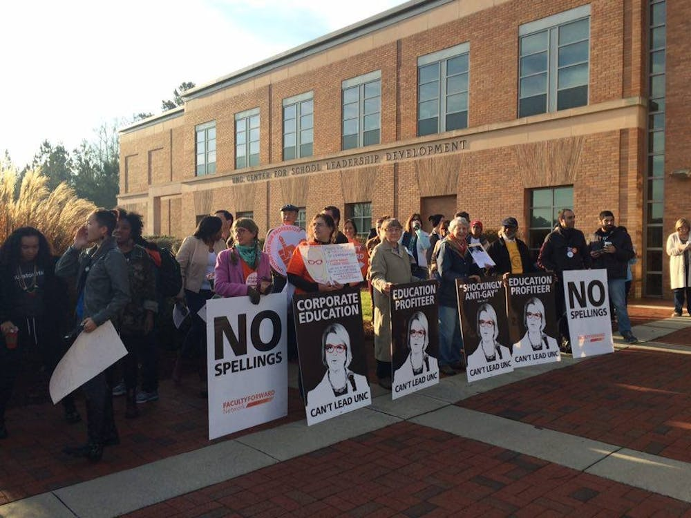 Protestors at Board of Governors meeting demand Spellings' dismissal