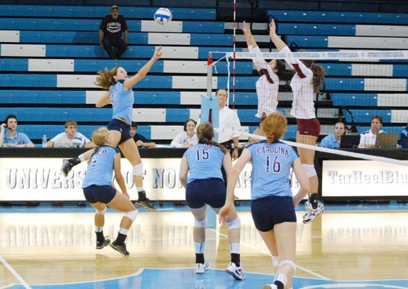 A UNC volleyball player prepares to knock the ball over the net. North Carolina has two preseason All-ACC players on its roster this season.