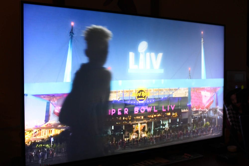 DTH Photo Illustration. Many companies are deciding if it is ethical to spend money on Super Bowl ads instead of COVID-19 relief efforts.
