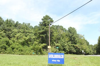 A sign at the proposed site for Research Triangle Logistics Park (RTLP) on Saturday, Sept. 5, 2020 advocates against the construction of the RTLP buildings on the 161-acre lot in Hillsborough, N.C.