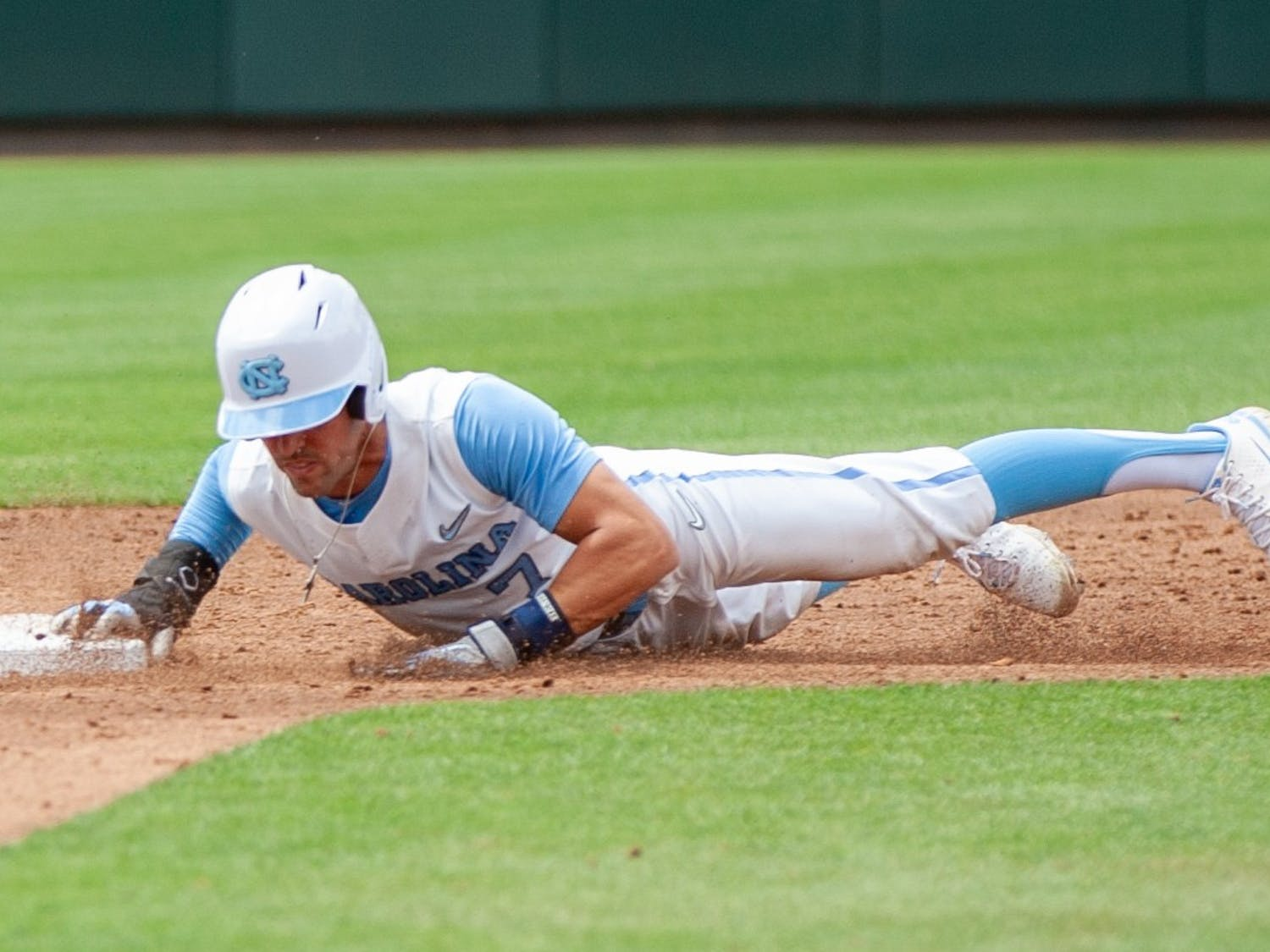 Senior outfielder Dallas Tessar (7) dives for second base at the game against Duke on Saturday Apr. 10 2021 at Boshamer Stadium. UNC lost 2-4.