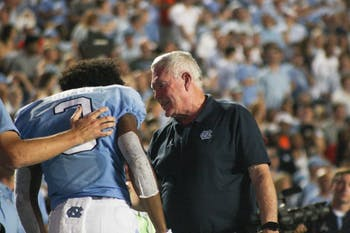 UNC football coach Mack Brown talks to number 3, wide receiver Antoine Green on Saturday, Sept. 7, 2019. UNC beat Miami 28-25.
