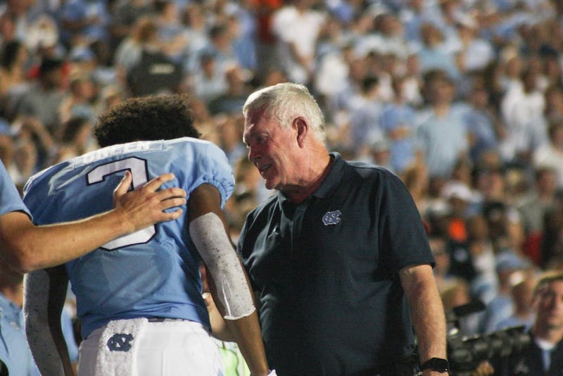 UNC football coach Mack Brown talks to wide receiver Antoine Green(3) on Saturday, Sept. 7, 2019. UNC beat Miami 28-25.