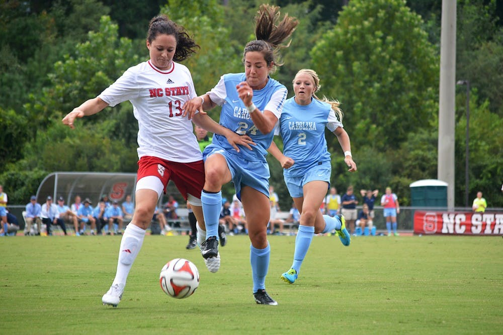 UNC's Paige Nielson (24) and NC State's Franziska Jaser (13) battle for the ball at Sunday's soccer game in Raleigh, North Carolina.  The Lady Tar Heel's won 2-1 against the Lady Wolfpack.
