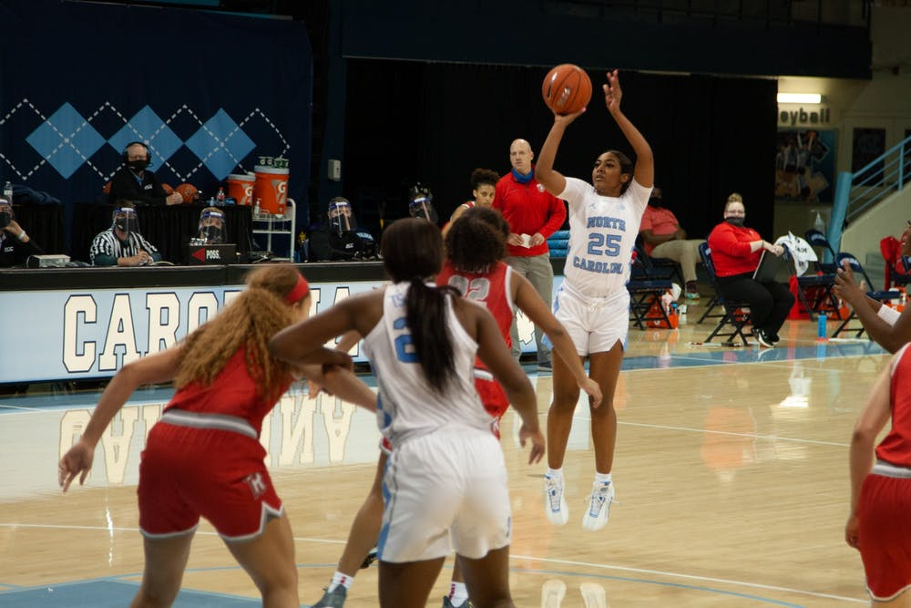 First year guard Deja Kelly attempts a three point shot during UNC women's basketball season opener against Radford on Wednesday, Nov. 25, 2020. UNC won 90-61.